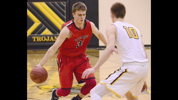HCHS senior Shane Chamberlain looks to drive around Atlantic's Austin Alexander during Tuesday's Hawkeye Ten game. (Photo courtesy of Nate Tenopir, Atlantic News-Telegraph)