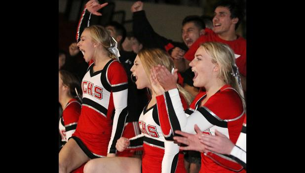 Cyclone cheerleaders (left-right) Nadia Baxter, Padyn Reep and Janesa Hendricks react to Nathan Henry's win. (Photos by Mike Oeffner)