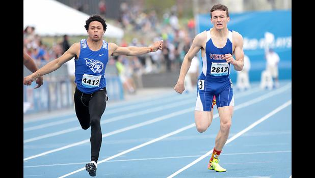 AHSTW senior Gage Clay (right) places fourth in the Drake Relays 100-meter dash Friday afternoon as West Liberty's Tanner Iske crosses the finish line in first place. Clay's time of 10.84 seconds was a new personal best. He was competing in his third Drake Relays 100 after placing 12th as a sophomore and 14th as a junior. (Photos by Mike Oeffner)