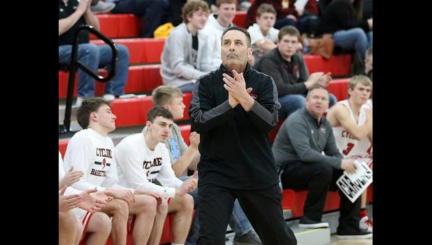 HCHS boys basketball coach Mitch Osborn applauds his team and checks the scoreboard during Saturday night's victory over Atlantic. On Friday, Osborn passed Jim Eekhoff on the state's list of career coaching wins and now ranks fifth all-time.