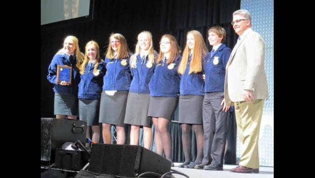 The Harlan FFA Conduct of Meetings team as they were announced the state champions in Hilton Coliseum- Abigail Jacobsen, Courtney Mumm, Bobbie Schechinger, Elise Juhl, Grace Kenkel, Lucy Borkowski, Dalton Gross.  (Photo contributed)