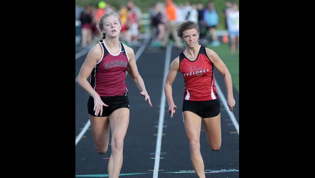 Harlan Community junior Sidney Craig (right) sprints alongside Clarinda's Lauren Bair in the 100-meter dash at Thursday's conference meet. Craig placed fifth in the event.