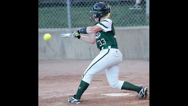 Wolves' third baseman Kate Crawford puts the ball in play.