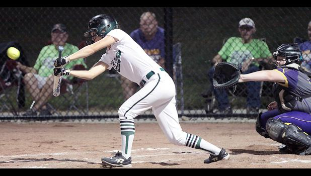 IKM-Manning senior Taylor Croghan drove in the Wolves' first run vs. Logan-Magnolia with this bunt single and later added a two-run double during Thursday's WIC Tournament title game. (Photos by Mike Oeffner)