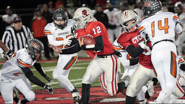 HCHS quarterback Deren Schmitz (12) runs for some of his 72 yards against Sergeant Bluff-Luton Friday with blocking help from Patrick Fah.