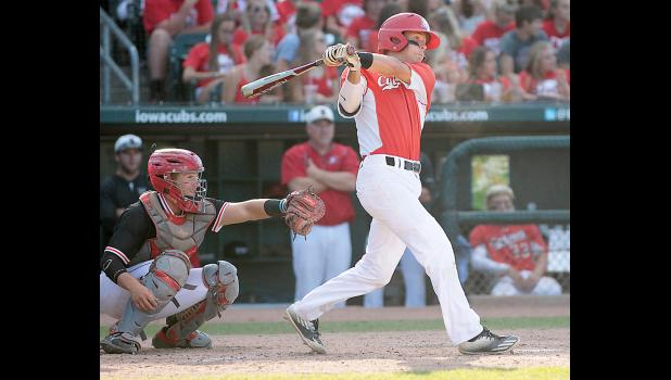 Harlan Community senior Dillon Sears rips a single in the top of the sixth inning before scoring the Cyclones' only run against Davenport Assumption.