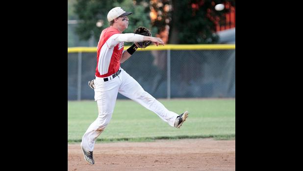 HCHS shortstop Dillon Sears throws on the run to record an out against Greene County in a 3-A district final game.