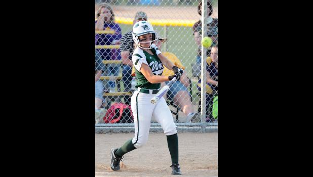 IKM-Manning's Mya Doyel puts the ball in play for a two-run triple in the sixth inning vs. Logan-Magnolia.