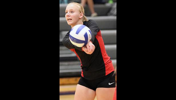 HCHS junior Elise Juhl makes a serve receive pass.