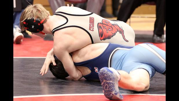 HCHS junior Ethan Lemon turns Lewis Central's Taber Dominguez to his back during their 126-pound championship match. Lemon won by fall in 3:48.