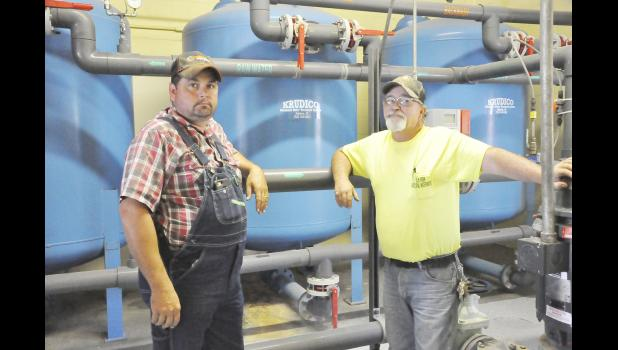 Andy Ring (left) and Jerry Evans at the Elk Horn Wastewater Treatment Plant.