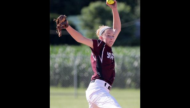 Exira-EHK eighth-grader Macy Emgarten delivers a pitch during her three-inning perfect game against Southwest Valley on Monday.