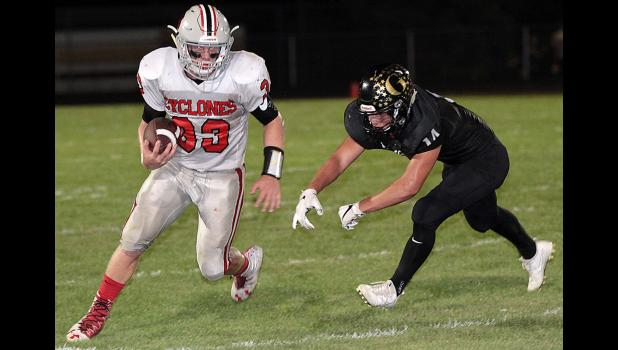 3A CAPTAIN -- Harlan Community senior Nick Foss (33) eludes a Glenwood tackler during the Cyclones' Week 4 win over the Rams. Foss was selected as the senior captain of this year's Class 3A All-State football team after scoring 38 total touchdowns.