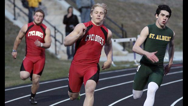 Harlan Community junior Nick Foss (center), competing at last week's Monarch Relays, won the long jump and placed in the top three of three other events at the Glenwood Ram Relays on Monday night.