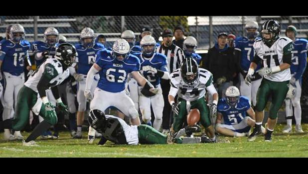 IKM-Manning senior Chris Monson tries to come up with a loose ball near the West Lyon sideline on Friday. The Wildcats ended up recovering the fumble and winning the state playoff contest 35-0. (Photos courtesy of Scott Beyers, Northwest Iowa Review)