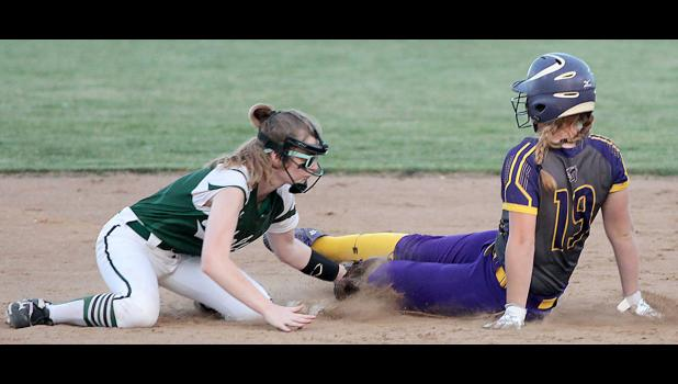 IKM-Manning shortstop Paige Gaskill tags out Logan-Magnolia's Abbie Carlson for the third out of the Panthers' two-run fourth inning Thursday night. Carlson's two-run single gave Lo-Ma a 5-4 lead but the Wolves rallied to win 7-5.