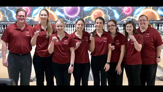 The Harlan Community girls earned second-place medals at the Le Mars Bowling Tournament on January 26. Left-right: Head Coach David Tyrrel, Olivia Petersen, Sydney O'Neill, Abby Swank, Jayden Gessert, Madison Horn, Ania Kaster, Assistant Coach Jami Andersen. (Photos contributed)