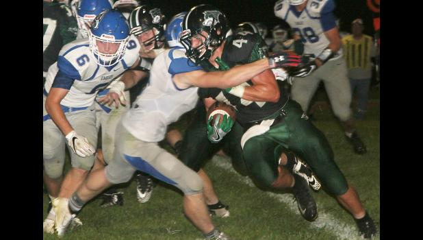 IKM-Manning fullback Stephen Grimm (44) rushes for some of his 79 yards against Underwood on Friday night.