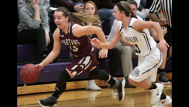 Spartan freshman Tatum Grubbs races upcourt after stealing the ball from Lady Bulldogs point guard Anna Puck.