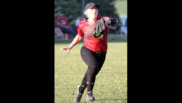 HCHS senior Molly Gubbels makes a running catch in left field. (Photo by Mike Oeffner)