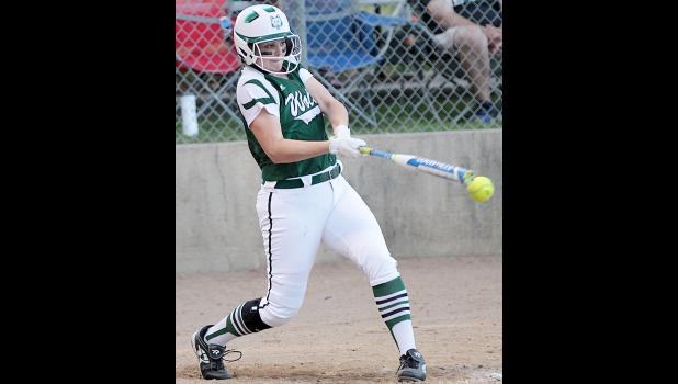 IKM-Manning's Sammy Halbur, who belted a two-run homer in the first inning, puts the ball in play during Thursday's win.
