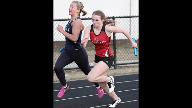 HCHS freshman Ashley Hall starts the third leg of the Cyclone 4x100 relay, which placed fifth.