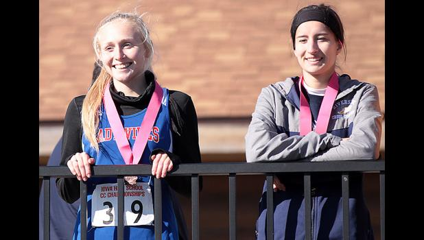 MEDALIST -- AHSTW's Heidi Hall (left) placed 15th in Class 1A at the state cross country meet on Saturday. Also pictured is Riverside's Alexis Post (14th).