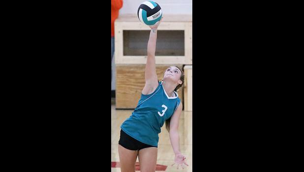 HCHS sophomore Ashley Hall serves against Red Oak.