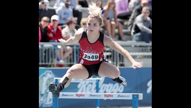 HCHS junior Chloe Hansen competes in the girls 400-meter hurdles at the Drake Relays on Saturday. Hansen placed 13th with a personal-best time of 1:07.14.