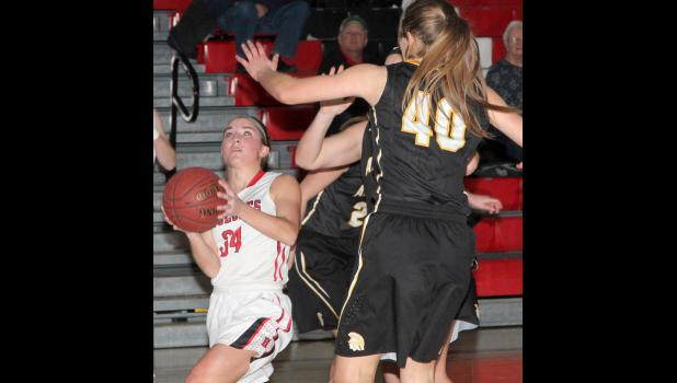 Cyclone junior Chloe Hansen looks to drive around Atlantic's Heidi Williams.