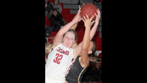 HCHS senior Lexie Holloway grabs a rebound.