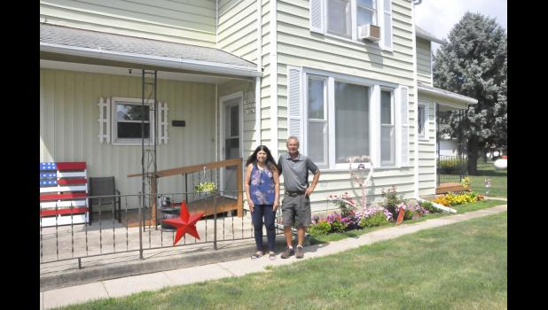 Tom and Kathy Musich in front of the 127-year-old house in Westphalia.