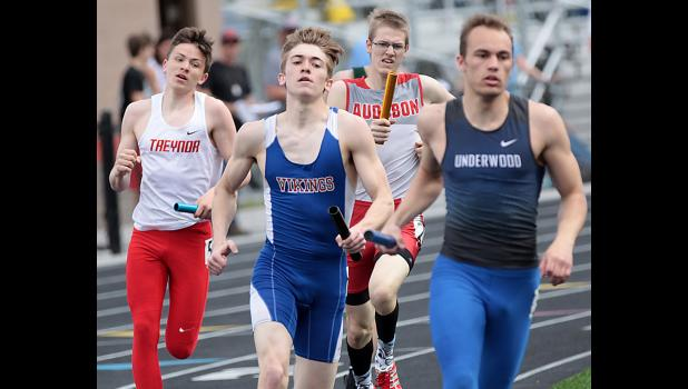 AHSTW senior Jake Martin (center) anchored the Vikings to first place in the sprint medley relay to start off the Western Iowa Conference Track Meet Tuesday afternoon.