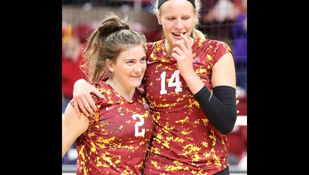 Schaben puts her arm around Iowa State freshman Taylor Baranski following the team's 3-1 win over the Mountaineers.