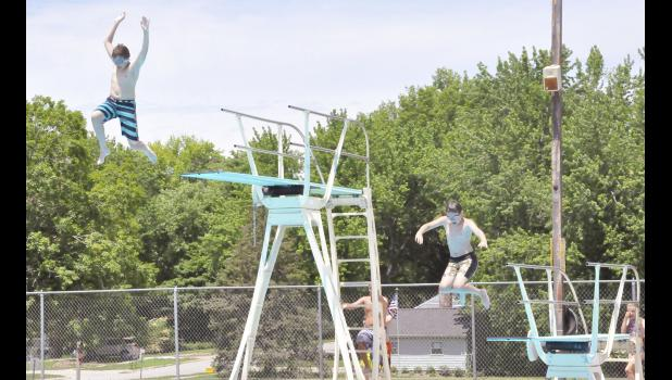 Pictured L to R: Alex Heithoff and Jacob Brouse jumping off the diving boards.