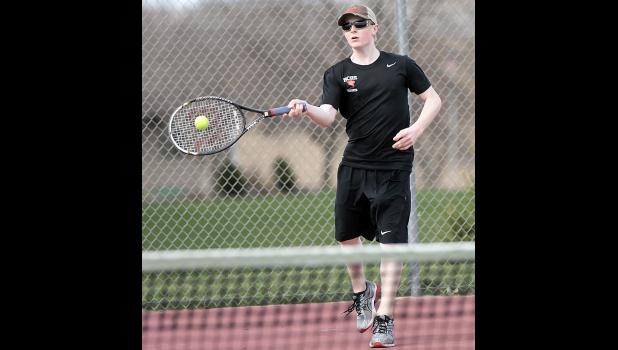 Kaleb Kaster of HCHS connects squarely on a forehand return shot during his 10-5 singles win over St. Albert's Nathan Rhedin on Friday. (Photos by Mike Oeffner)