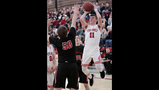 HCHS senior Logan Klaassen (11) shoots over Creston's Jaden Driskell for two of his 26 points during Friday's substate semifinal win over the Panthers.