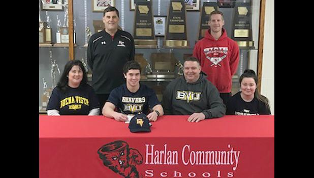 HCHS senior Luke Schaben is seated next to his parents, Jeff and Donna Schaben, of rural Earling. At right is Luke's sister Dana. Standing behind the Schaben family are HCHS assistant baseball coaches Mark Vande Berg (left) and Heath Stein. Not pictured: HCHS head coach Steve Daeges and assistant coach Joe Heese. (Photo contributed)