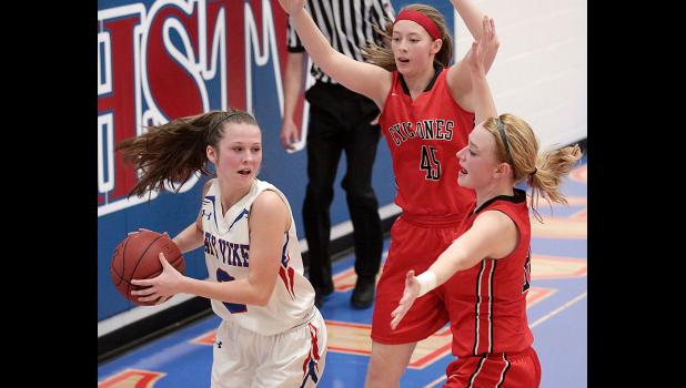 AHSTW senior Josie Denning (left) is trapped along the baseline by HCHS junior Olivia Petersen (45) and senior Lexi Larsen.
