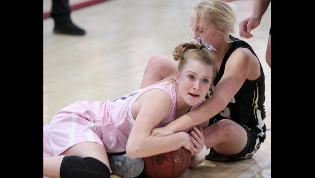 HCHS senior Lexi Larsen battles a Glenwood player for control of the ball during Friday's home win.