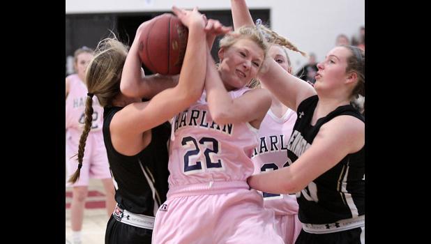 HCHS freshman Macie Leinen (22) battles for a rebound. (Photos by Mike Oeffner)