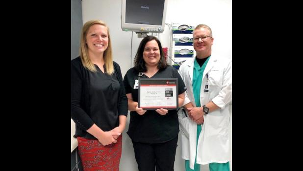 Presenting the award to Jenny Lefeber, manager of Myrtue's Emergency Department, and Dr. Scott Markham is Katie Bergan (left), Director, Quality and Systems Improvement with the American Heart Association.  (Photo contributed)