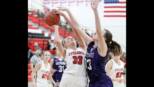HCHS sophomore Macie Leinen (left) attempts a shot against Nodaway Valley's Corinne Bond.