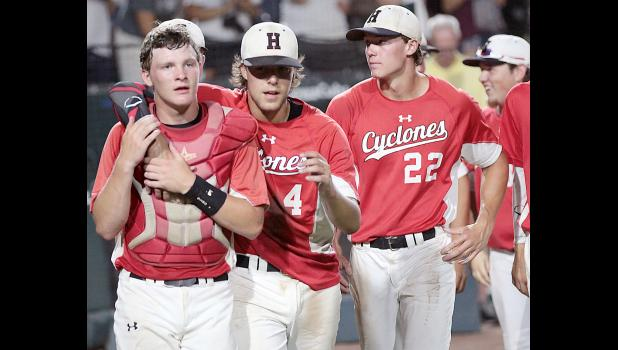 HCHS winning pitcher Brett Sears puts his arm around catcher Jared Moser following Tuesday's 6-0 state tournament win over Oskaloosa. Also pictured are Kyle Schmitz (22) and Spencer Boardman.
