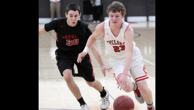HCHS point guard Jared Moser (23) drives past Creston freshman Brance Baker.
