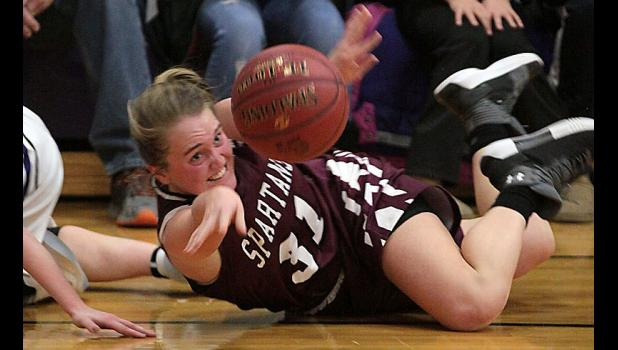 Exira-EHK senior Kealey Nelson passes the ball toward a teammate after diving on the floor for a loose ball in Tuesday's game at Boyer Valley. (Photos by Mike Oeffner)
