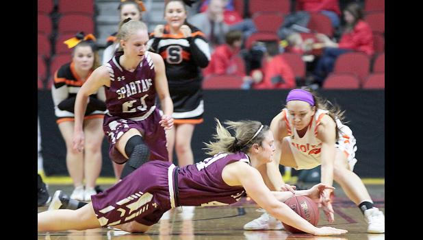 Spartan senior Sophia Peppers dives after a loose ball during Friday's second half as Rylee Menster of Springville also reaches for the basketball and Spartan sophomore Ellie Schultes looks on.