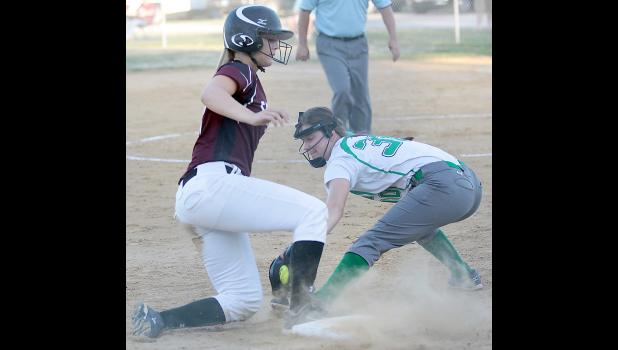 FONDA -- Spartan junior Sophia Peppers beats the tag of St. Edmond's Erin Flattery (30) for a triple during the sixth inning of Friday's regional semifinal game.