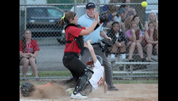 Sergeant Bluff-Luton's Kylie Kerr slides home safely as Cyclone catcher Madison Schumacher waits for a throw during the Warriors' 5-3 win at H. Jack Field.