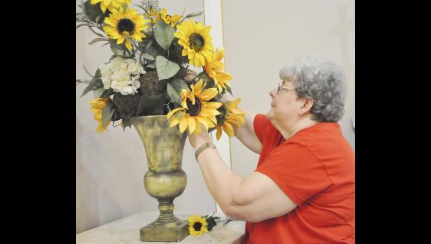 Margaret Petsche became a sacristan and enjoys making flower arrangements.
